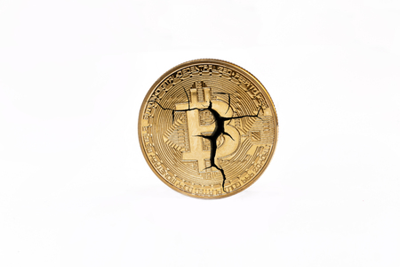 Cracked bitcoin coin isolated on white background