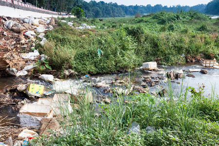 Big rubbish dump by the road and river, ecological disaster