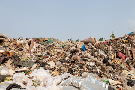 Big rubbish dump and blue sky, ecological disaster Standard-Bild