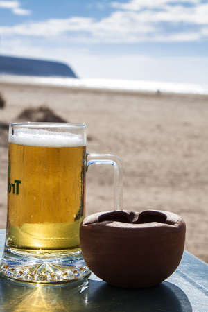Image of Cold beer at the beach photo