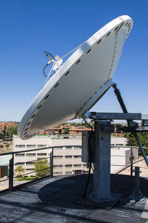 dish disk: Image of satellite dish in blue sky Stock Photo