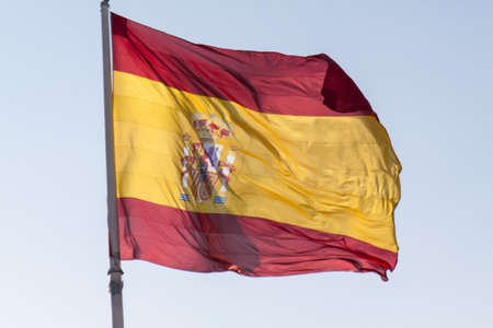 Spanish Flag blowing in the wind photo