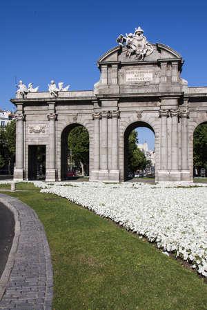 grassplot: 18th century Puerta de Alcala. Center of Madrid, Spain.