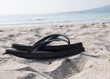 Black flip-flop in the beach photo