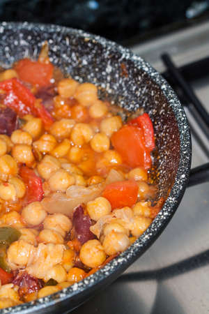 Garbanzos y Chorizo - Chickpeas and spicy sausage with red  photo