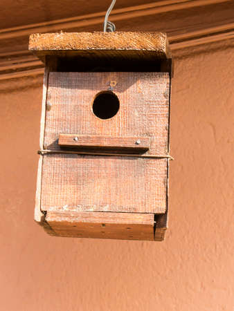 Isolated Hanging bird house.  photo
