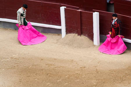 bullfighters: Bullfighters waiting for the bull at the arena