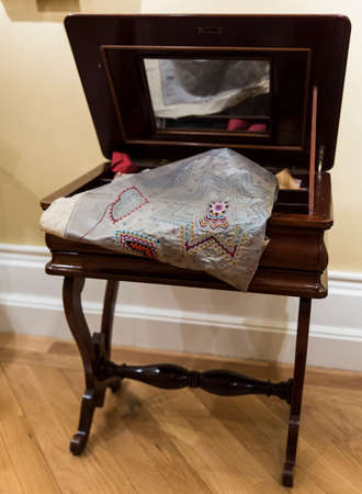 sewing box: Antique wooden sewing box with a mirror