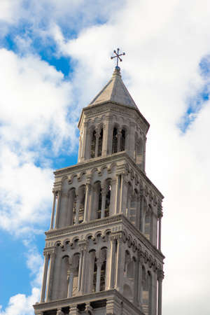 Top of the saint dominus belltower, old  heritage cathedral in the palace in split, croatia. Beautiful blue sky in the background Stock Photo