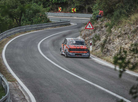 Skradin Croatia, June 2020 Simple grey old timer modified for hill climb racing up hill, going through a bend at high speed