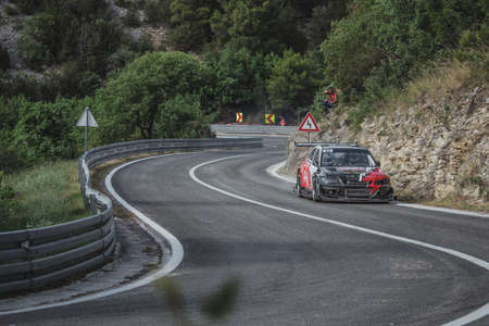 Skradin Croatia June 2020 Heavily modified Mitsubishi Lancer driven by Domagoj Perekovic going at high speed through a corner