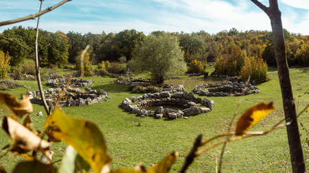 Ancient roman Rajcica wells located in the countryside of Croatia, 40 km away from Split. Round stone formations hidden in the forest overgrown with beautiful green grass. Pasture for local cows
