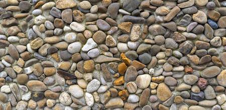 stone wall texture background, sea pebble sea stones