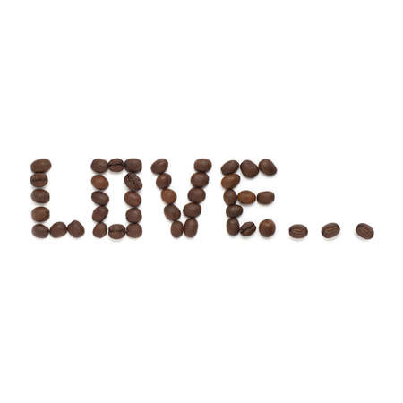 Word love shaped from roasted coffee beans.