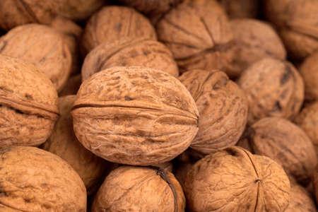 walnut on blurry background, selective focus, full screen image. 免版税图像