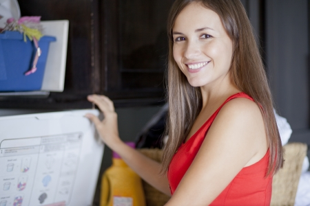 laundry room: Cute woman doing laundry Stock Photo