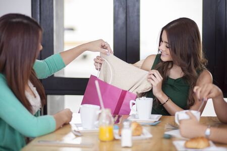 Cute woman opening her birthday gifts  photo