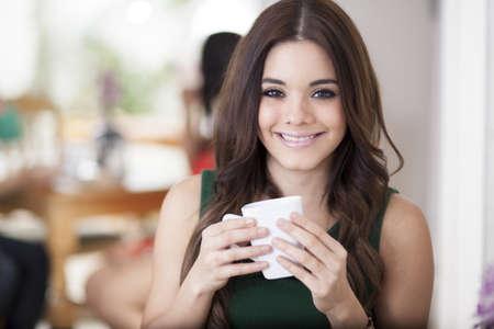coffee table: Cute girl loving her coffee