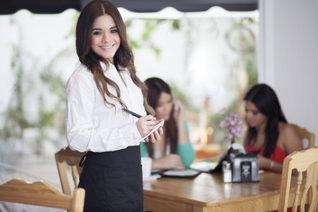 Waiting tables with a smile  photo