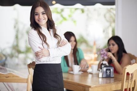 coffee table: Beautiful waitress loving her job  Stock Photo