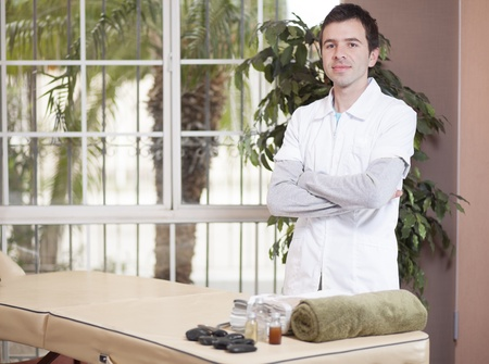 Handsome young therapist waiting for his next patient photo