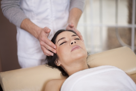 pain relief: Gorgeous young woman relaxing and being pampered at a spa