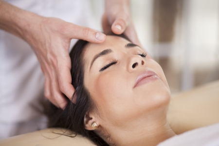 Cute woman getting pampered at a spa photo