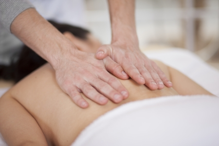 therapists: Cute chubby woman getting a back massage at a spa Stock Photo