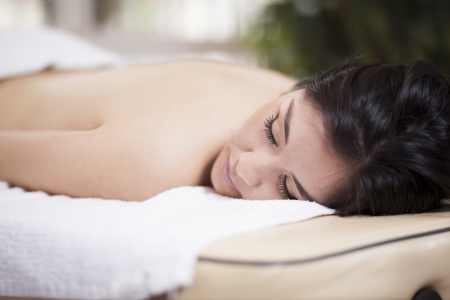 Cute chubby woman asleep after a massage session photo