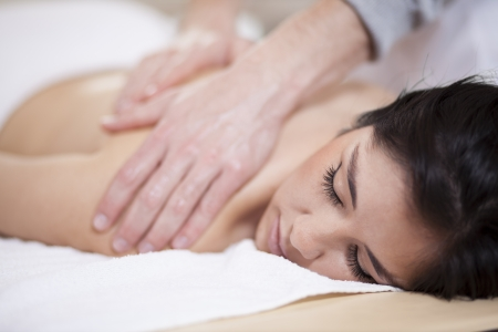 pain relief: Very relaxed young woman getting a massage Stock Photo