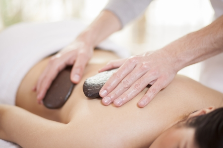 Hot stones doing their thing at a health and beauty spa photo