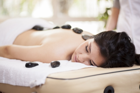 Beautiful woman enjoying a hot stone massage at a spa Stock Photo - 18184192