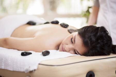Beautiful woman enjoying a hot stone massage at a spa Stock Photo - 18184192
