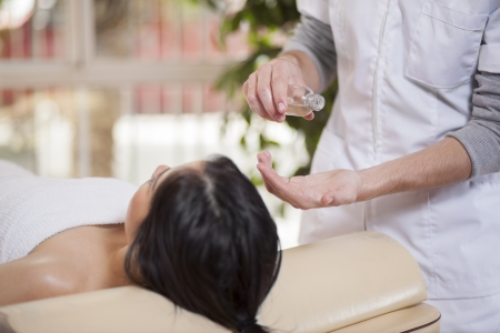 pain relief: Getting some rubbing oil for a massage
