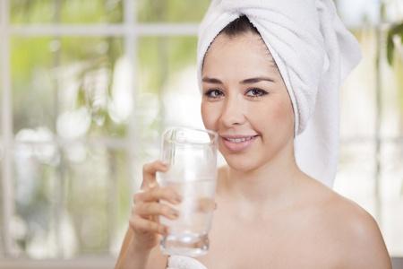 Cute young healthy woman drinking water Reklamní fotografie