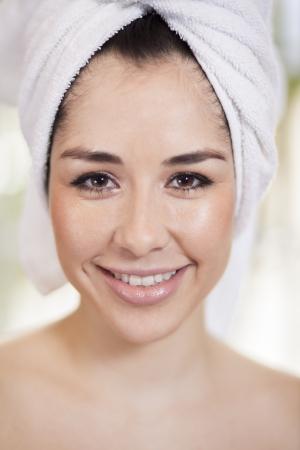Beautiful young woman at a beauty spa photo