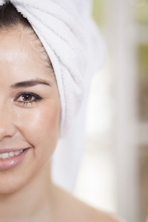 Portrait of a beautiful young woman at a beauty spa cut in half photo