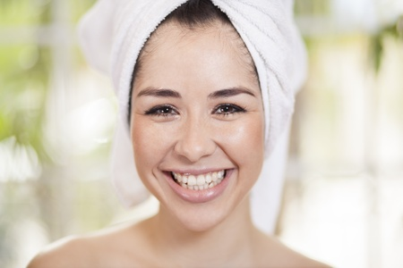 Cute young woman at a beauty and massage spa photo