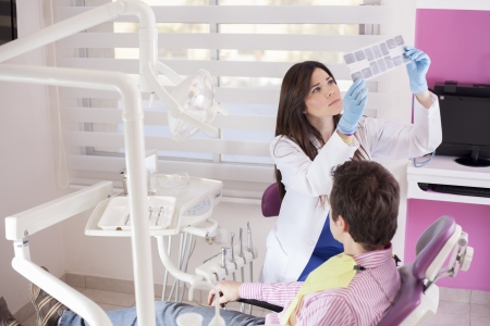 Female dentist reviewing the x-rays of a patient Stock Photo - 18269569