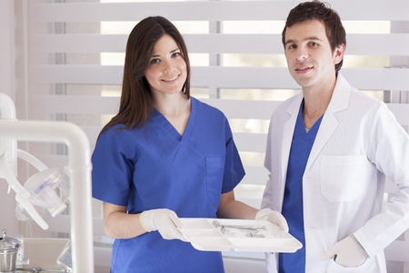 gloves nurse: Happy dentist and assistant loving their jobs Stock Photo