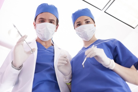 oral surgery: Doctor and nurse about to perform a surgery Stock Photo