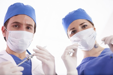 Couple of dentists ready to perform surgery photo