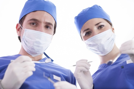 Young doctor and assistant in surgical scrubs ready to operate on a patient photo