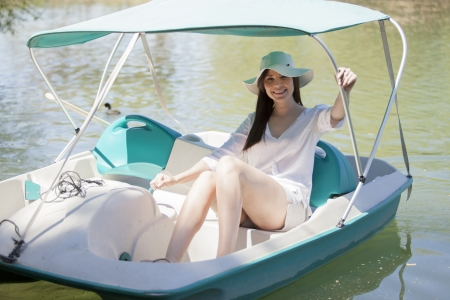pedal: Cute girl riding a pedal boat Stock Photo