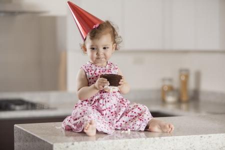 Beautiful baby girl eating cake for her birthday Stock Photo - 18639779