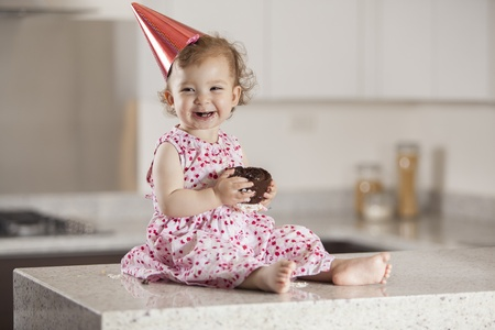 Cute baby girl celebrating her birthday with cake Stock Photo - 18639675