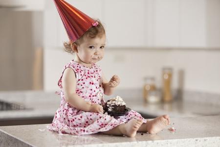 Sad birthday girl eating cake Stock Photo - 18639670