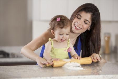 mother helping baby: Helping mom cook dinner Stock Photo