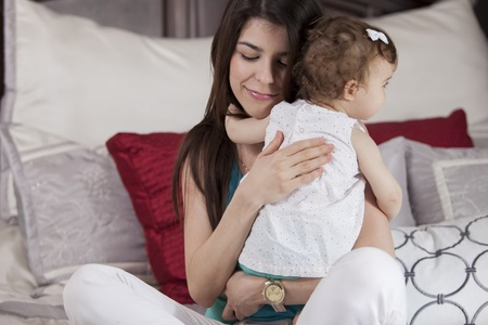 Cute young mother hugging her baby girl Stock Photo - 18639694