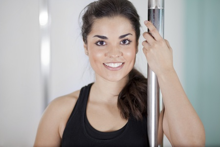 Beautiful happy woman smiling and loving her pole fitness class Zdjęcie Seryjne